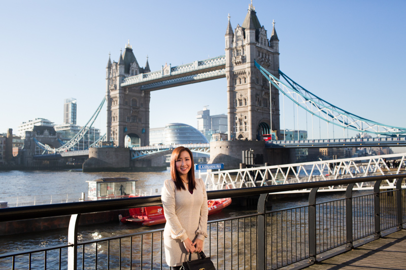 Lady in front of Tower Bridge