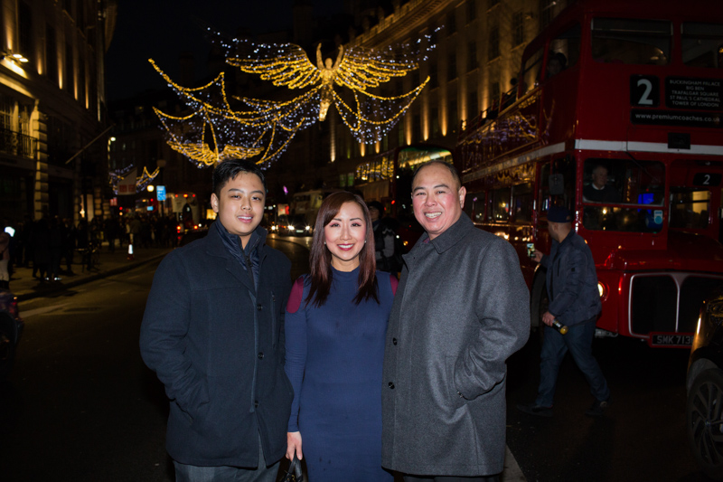 family in regents street with Christmas lights