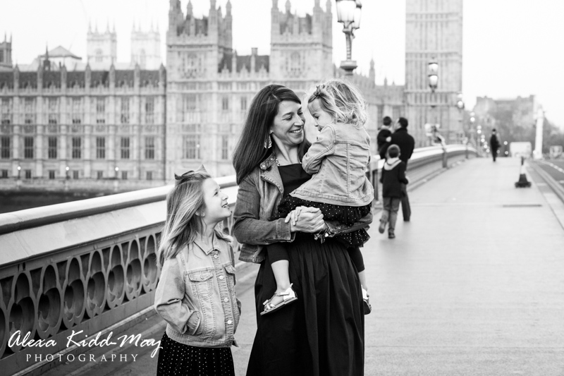 mother and 2 daughters standing on Westminster Bridge