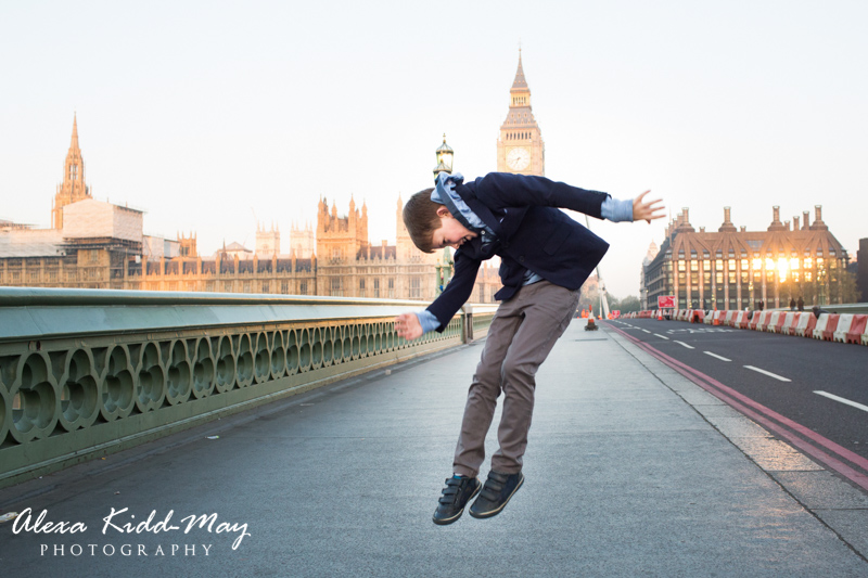 boy jumping on Westminster Bridge