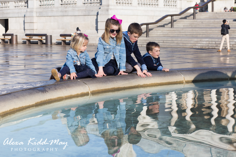 four children looking at a fountain in Trafalgar Square