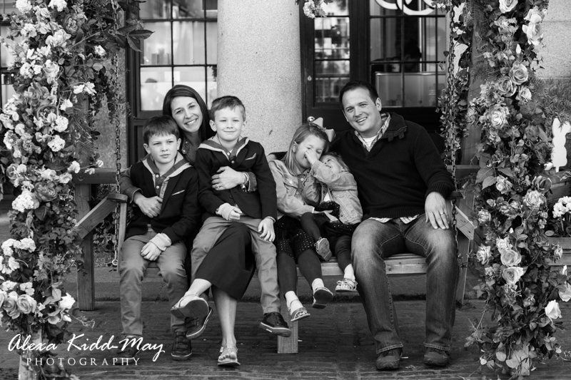 family sitting on a swinging chair in Covent Garden