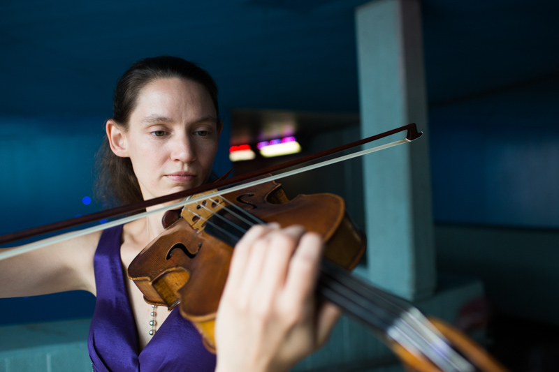 Lady playing her viola at London's Southbank.