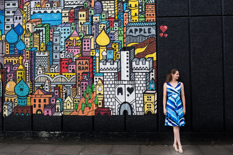 Lady standing by painted wall at London's Southbank