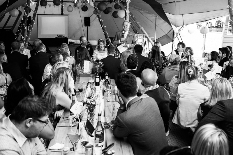 The father of the bride makes his speech in a tepee at North Hill Farm, Chorleywood.