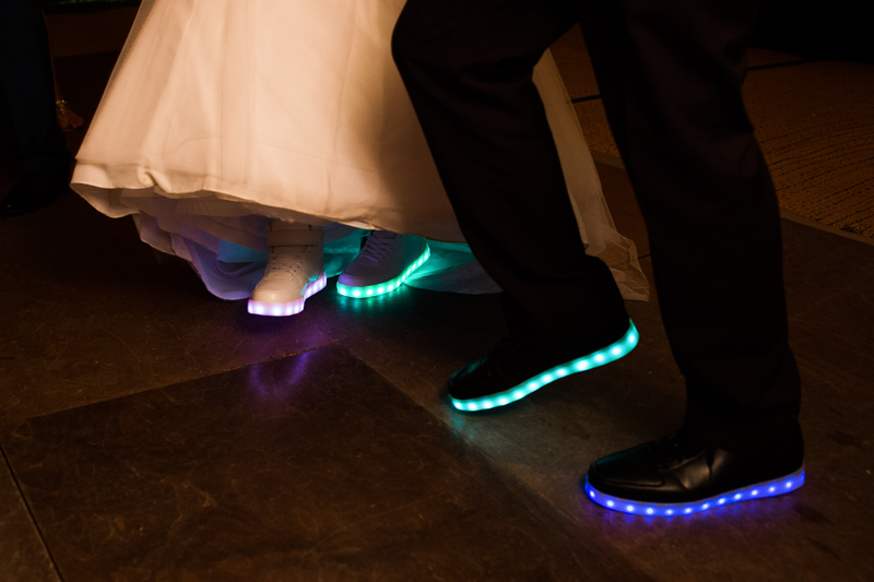 Bride and groom dancing at their wedding, in light up trainers, at North Hill Farm, Chorleywood.