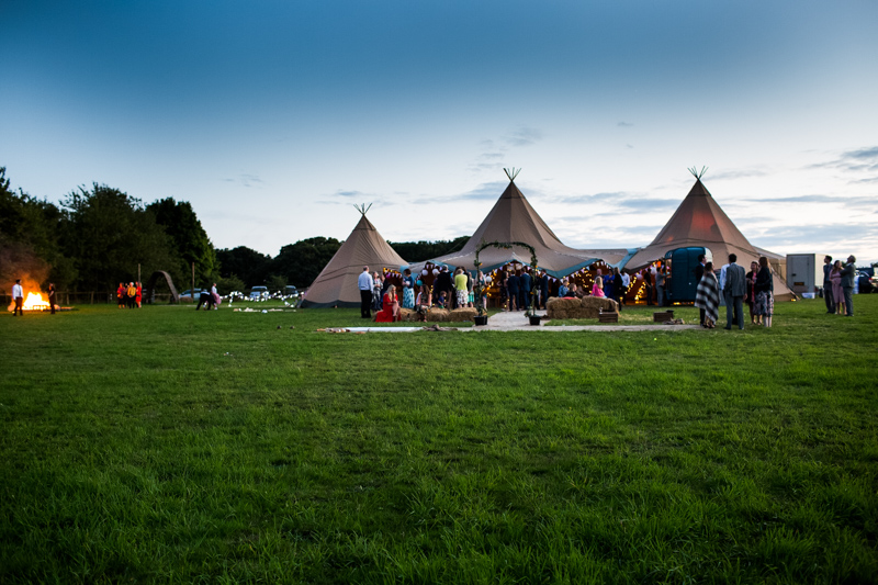 The sun sets over the wedding tepees at North Hill Farm, Chorleywood.