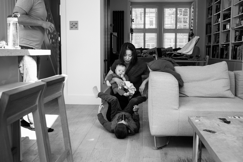 family playing in their house in Ealing in a half a Day in the Life photography session