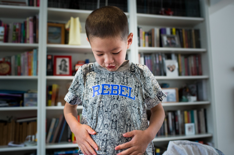 boy looking it his Rebel Tshirt in a half a Day in the Life photography session