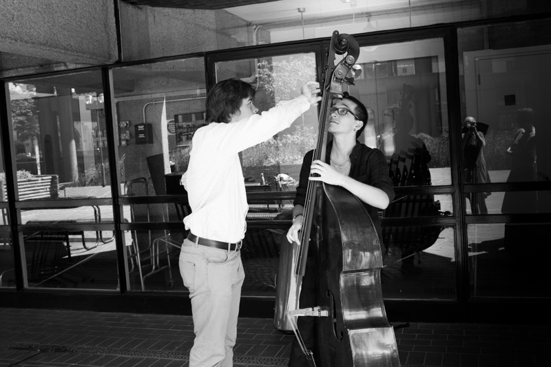 Two men playing with a double bass at the Guildhall School of Music and Drama, Barbican
