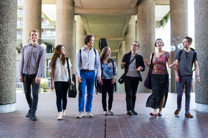 A group of musicians walking at the Guildhall School of Music and Drama, Barbican