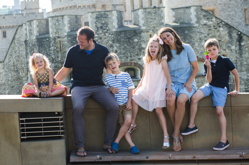 Mum, Dad and four children in front of the Tower of London.