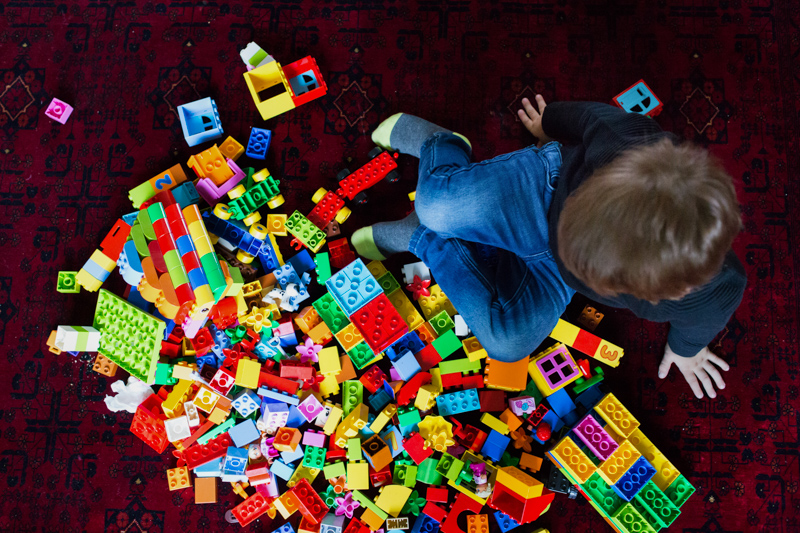 Aerial shot of boy and his lego.