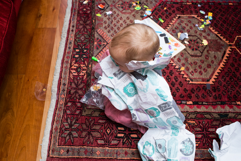 Baby wrapped up in paper.