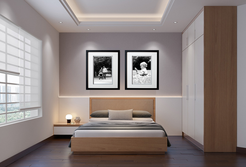 Two framed prints above a bed.