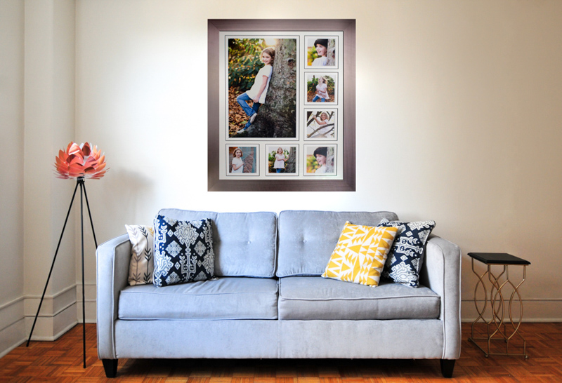 A frame of photos above a sofa and cushions.