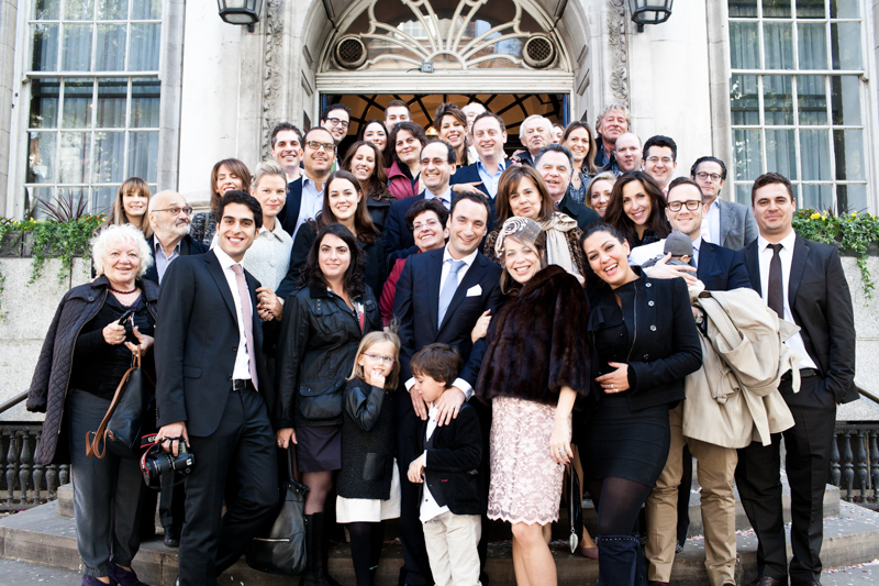 Wedding group shot on steps of Chelsea Old Town Hall