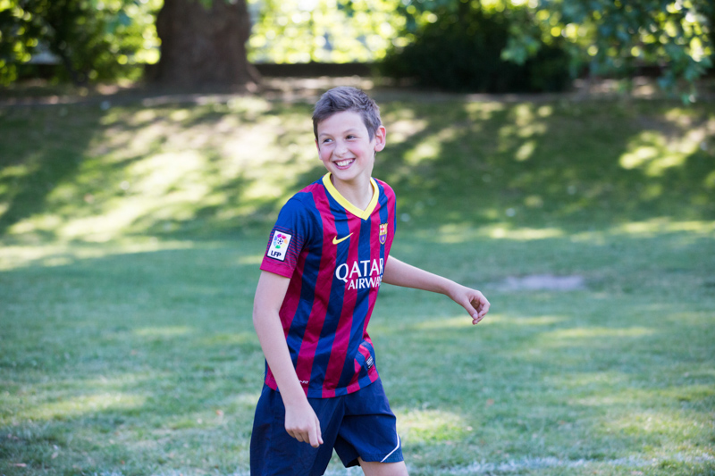 Boy smiling in the park.