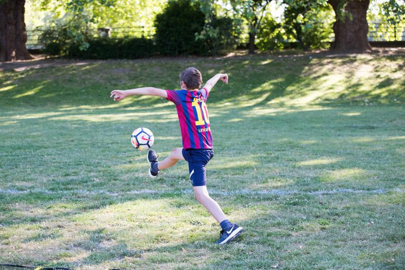 Boy doing a funny football kick.