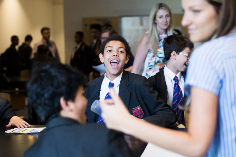 School pupil laughing with friends.