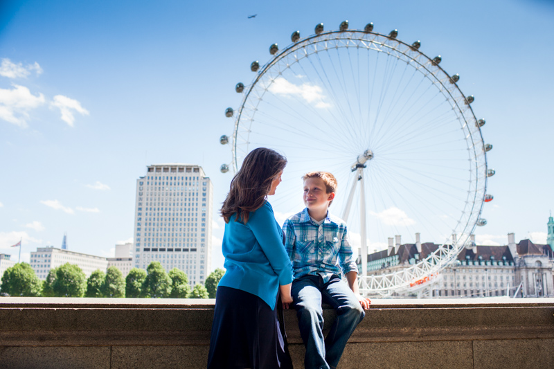 Mum and son in front of the London Eye.