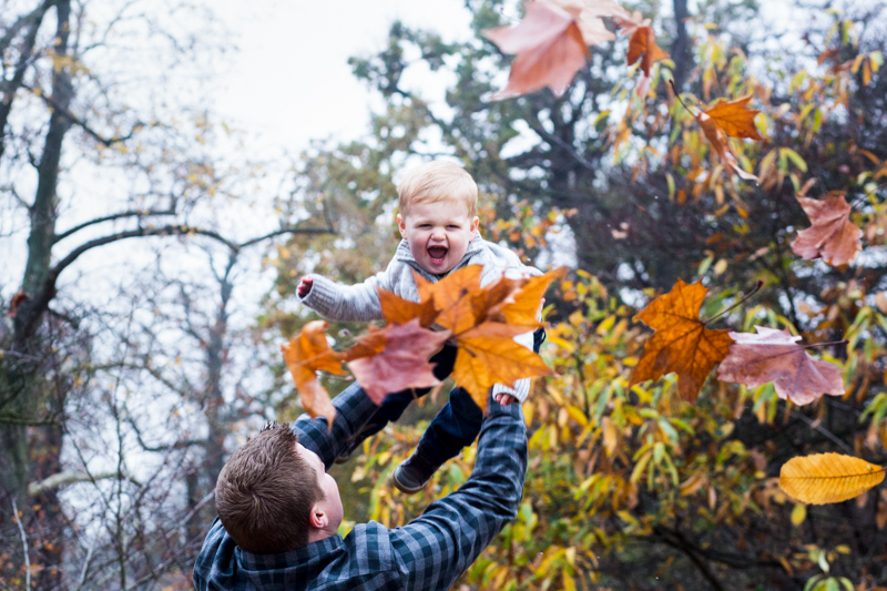 baby in the air with autumn leaves