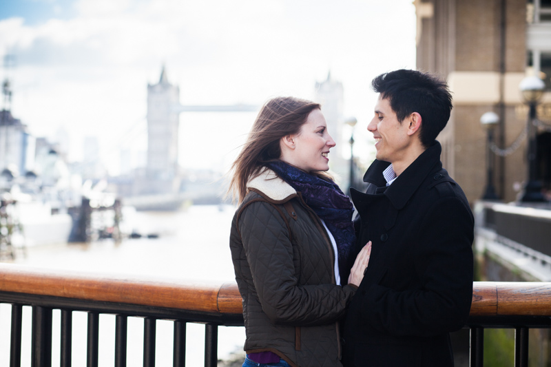 Man and lady looking at each other with Tower Bridge in the background.