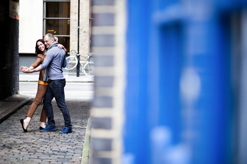 Couple dancing with blue door in foreground.