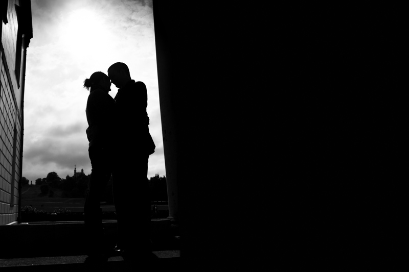 Silhouette of couple with Royal Observatory in the background.