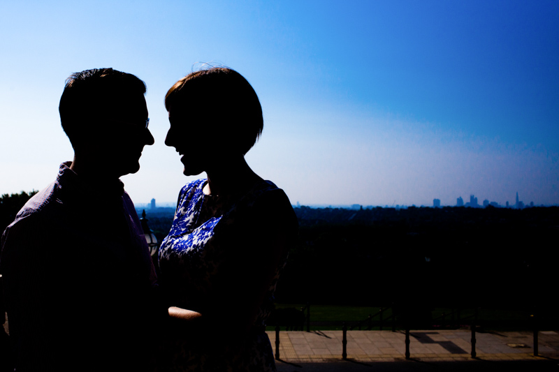 Silhouette of couple with London in the background.
