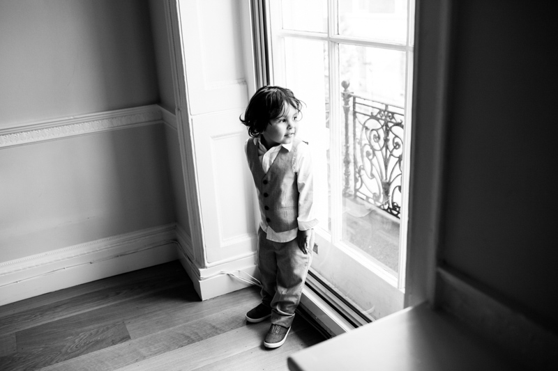 Pageboy looking at of large window.