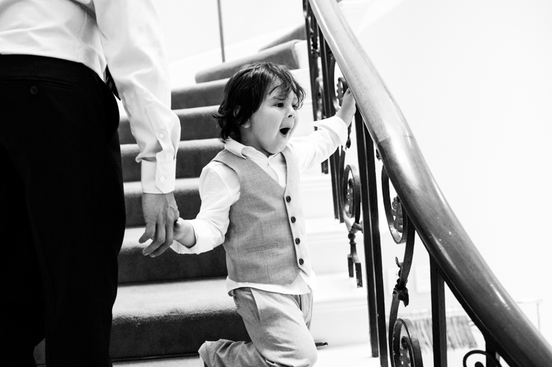 Boy walking down stairs looking excited.