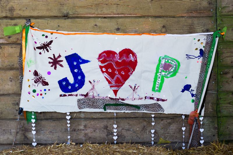 Colourful painted sign of J and P