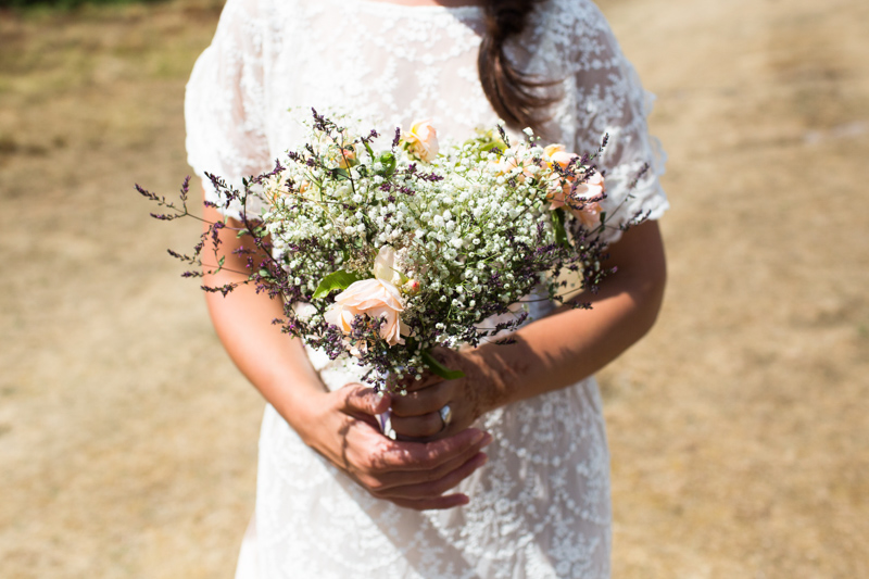 Bride holding bouquet of flowers.