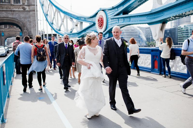 Wedding couple walking on Tower Bridge London.