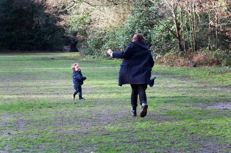 Teenage girl running after little boy.