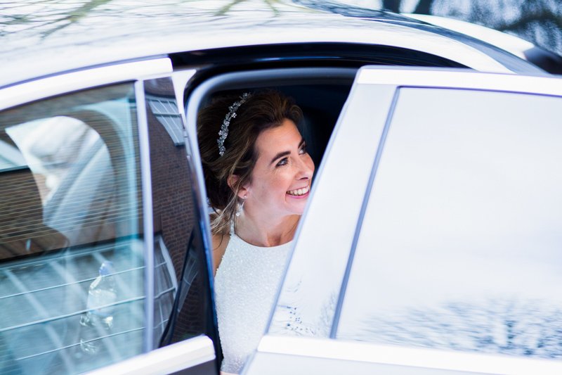 Bride about to get out of wedding car.