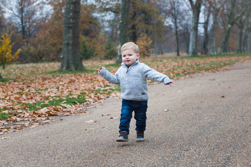 Boy walking through the park.