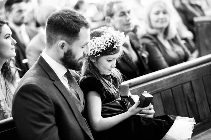 Bridesmaid looking in ring box.