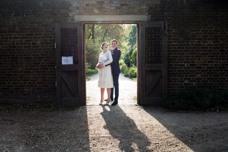 Bride and groom in a doorway.