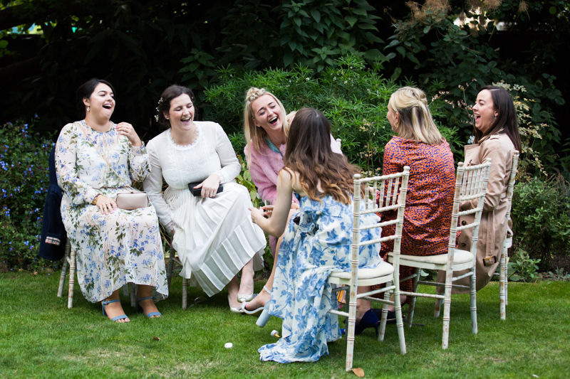 Bride and friends laughing.