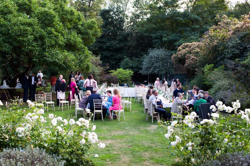 Wedding party in beautiful garden.