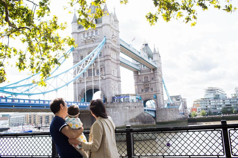 Lady, man and baby looking at Tower Bridge.