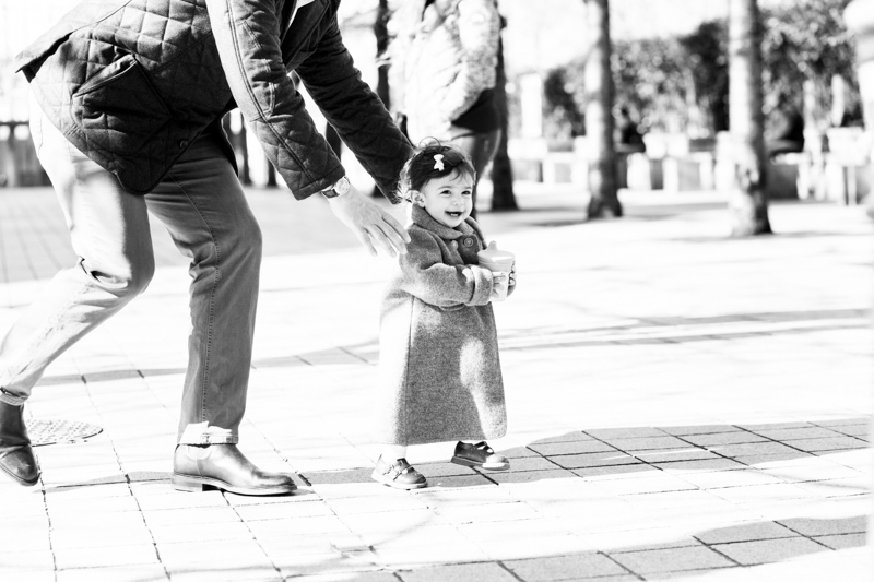 little girl running away from outstretched arms