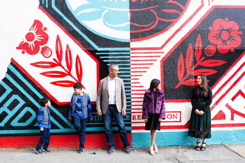 fun family photography portrait with colourful wall