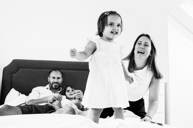 man, lady and two girls at home