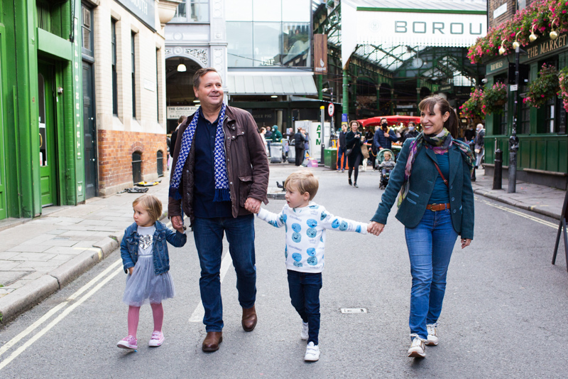 Mum, dad, boy and girl walking in front of Borough Market.