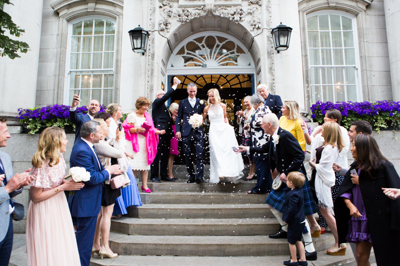 Bride and groom on the steps of Chelsea Old Town Hall