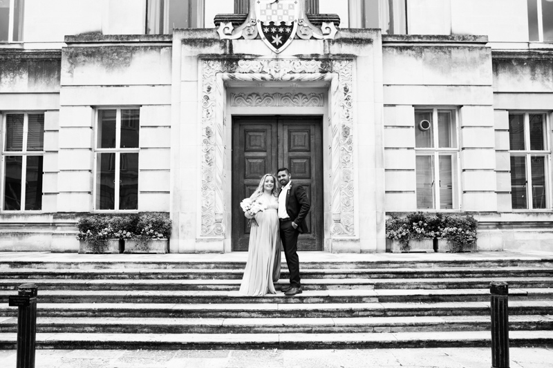 Bride and groom standing on steps.